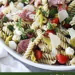 Italian pasta salad in a white bowl with text overlay optimized for pinterest