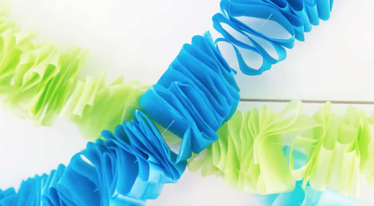 close up of ruffled blue tissue paper on a string