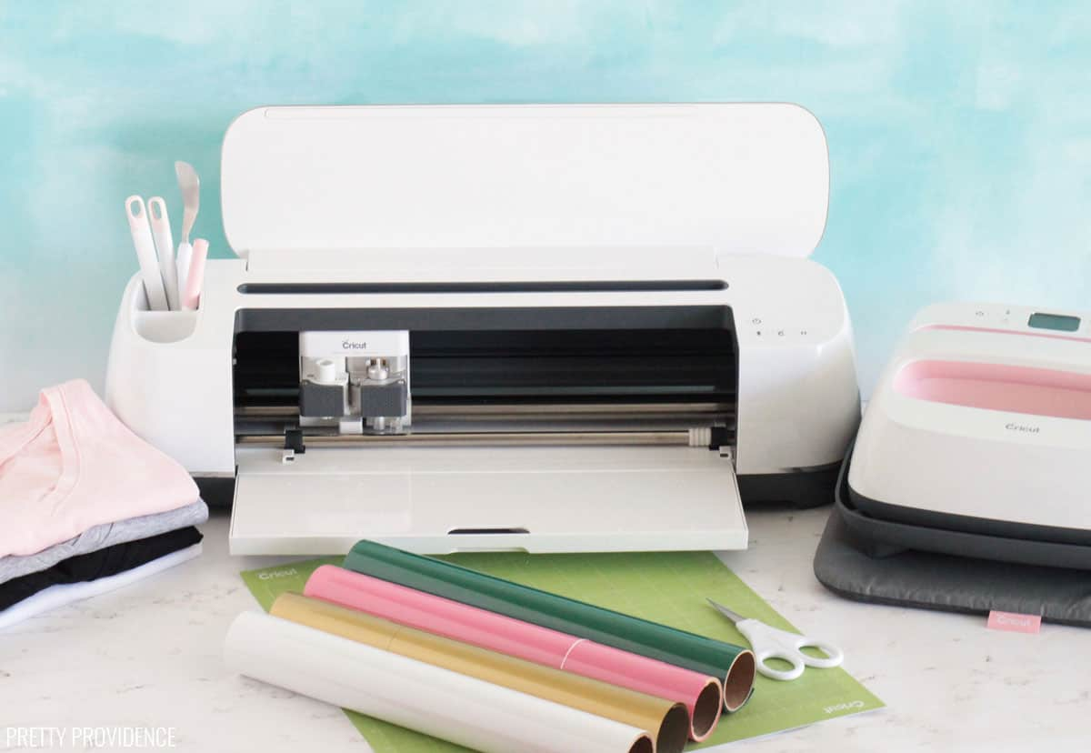 Cricut Maker, t-shirts, iron-on vinyl, easypress and other materials needed to make a shirt with iron-on