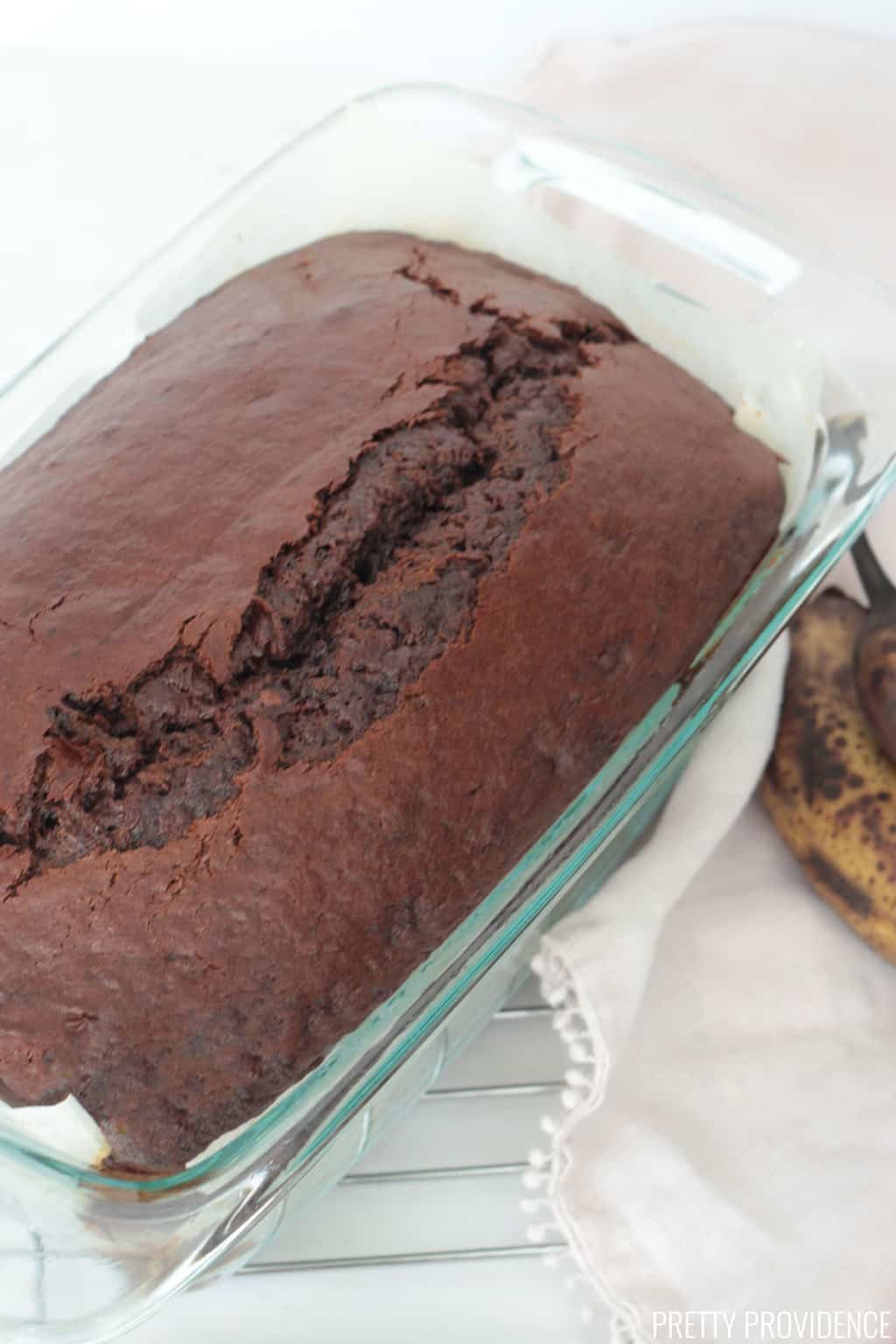Chocolate banana bread loaf in glass loaf pan