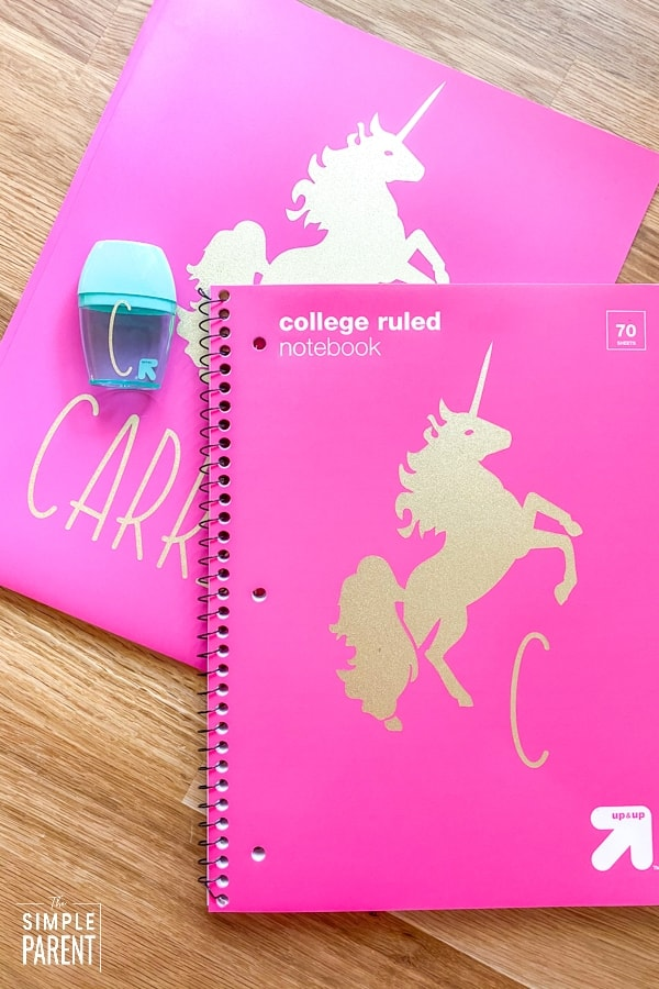 Unicorn gold stickers and initials on pink folders for school