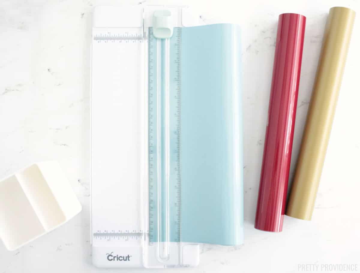 Cricut paper cutter cutting light blue vinyl