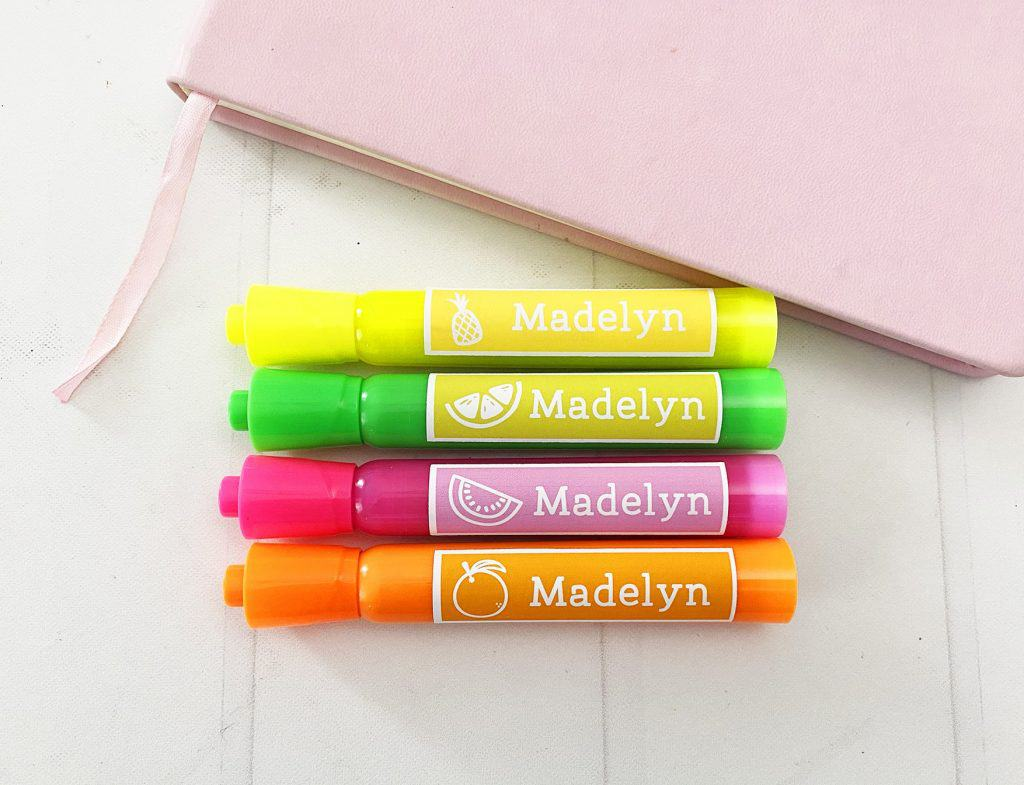 Custom Highlighters with stickers and name 'madelyn' on them.