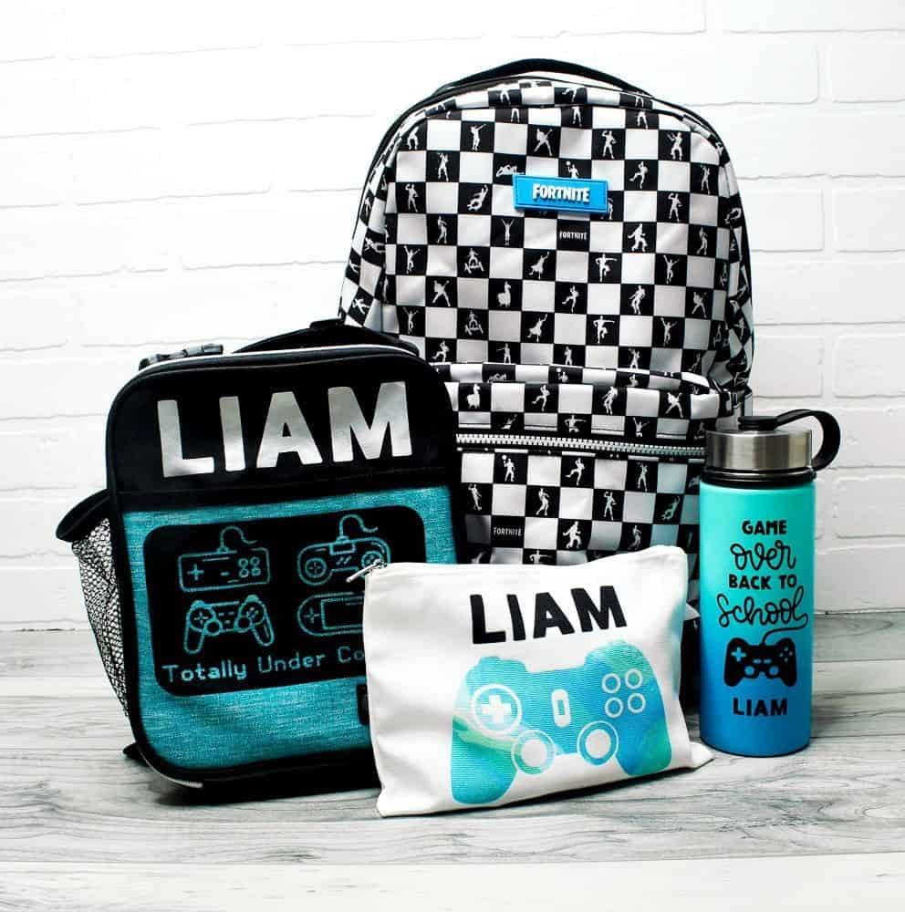 Video game themed backpack, lunch box, pencil case and waterbottle.