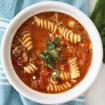 close up birds eye view of a bowl of lasagna soup