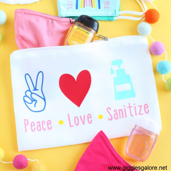 Mask bag and hand sanitizer with 'Peace Love Sanitize' on it