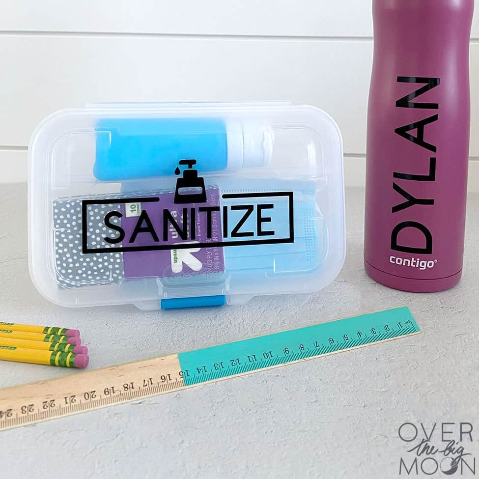 "Sanitizing kit for school and water bottle with label ""Dylan"""