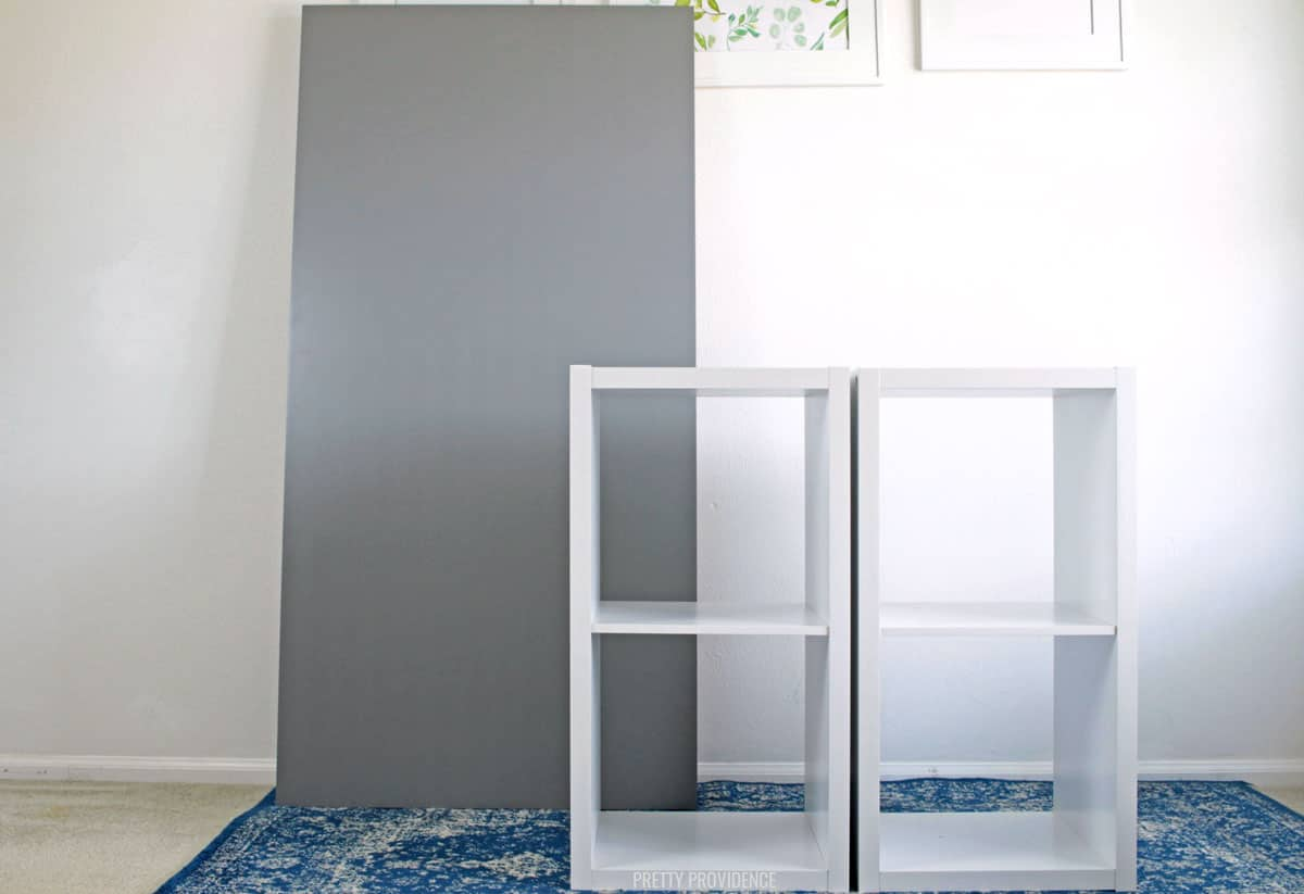 two white cube bookshelves and gray IKEA desk top