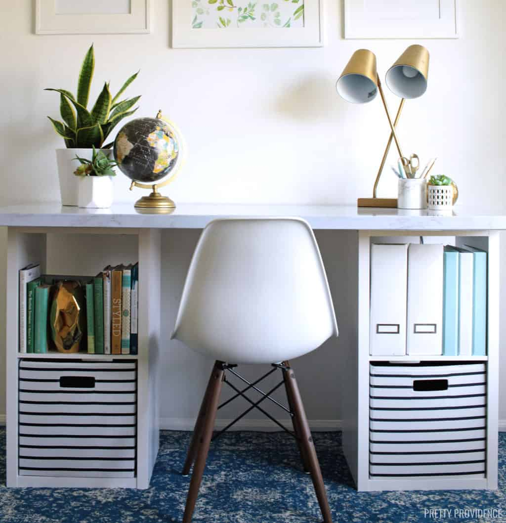 modern desk with storage cubes for legs, lamp and white chair
