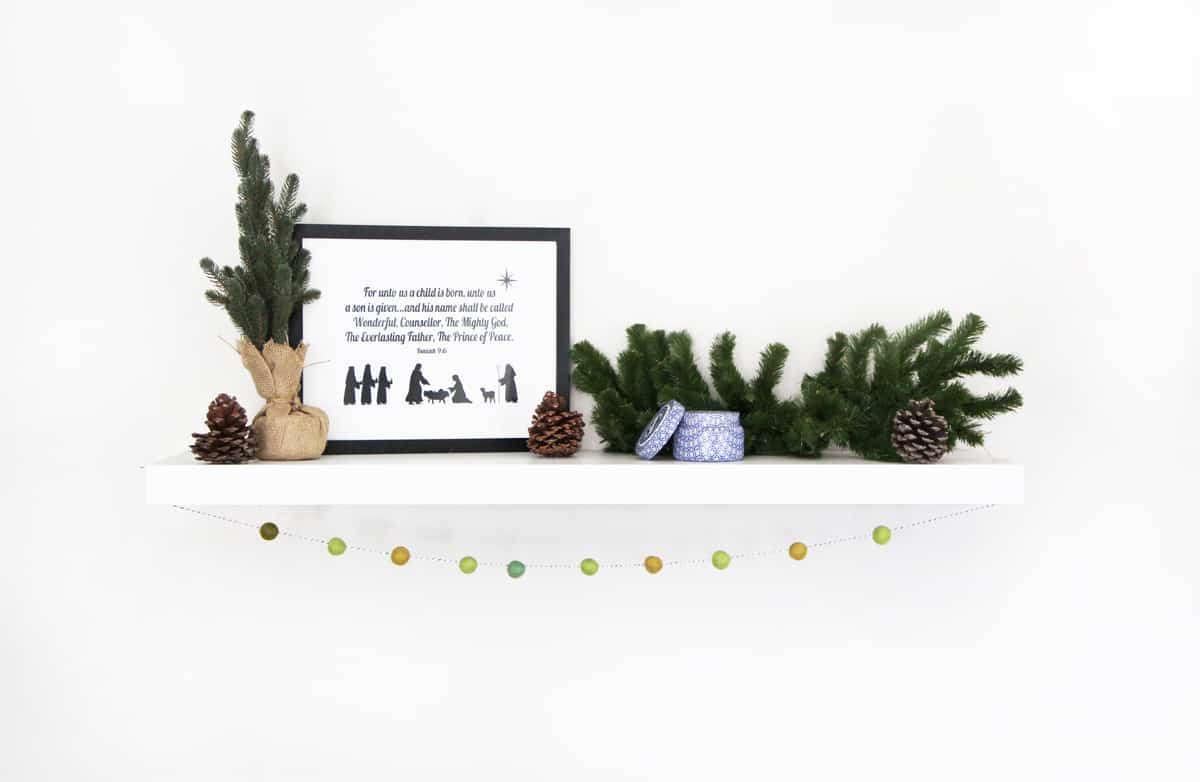 free printable nativity scene on a white shelf with garland