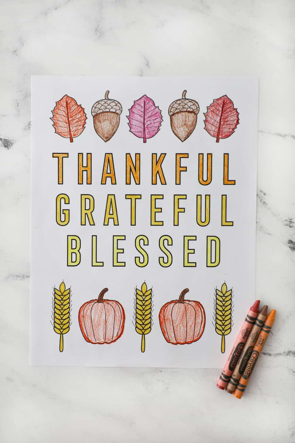 thankful grateful blessed coloring page on a granite countertop with crayons