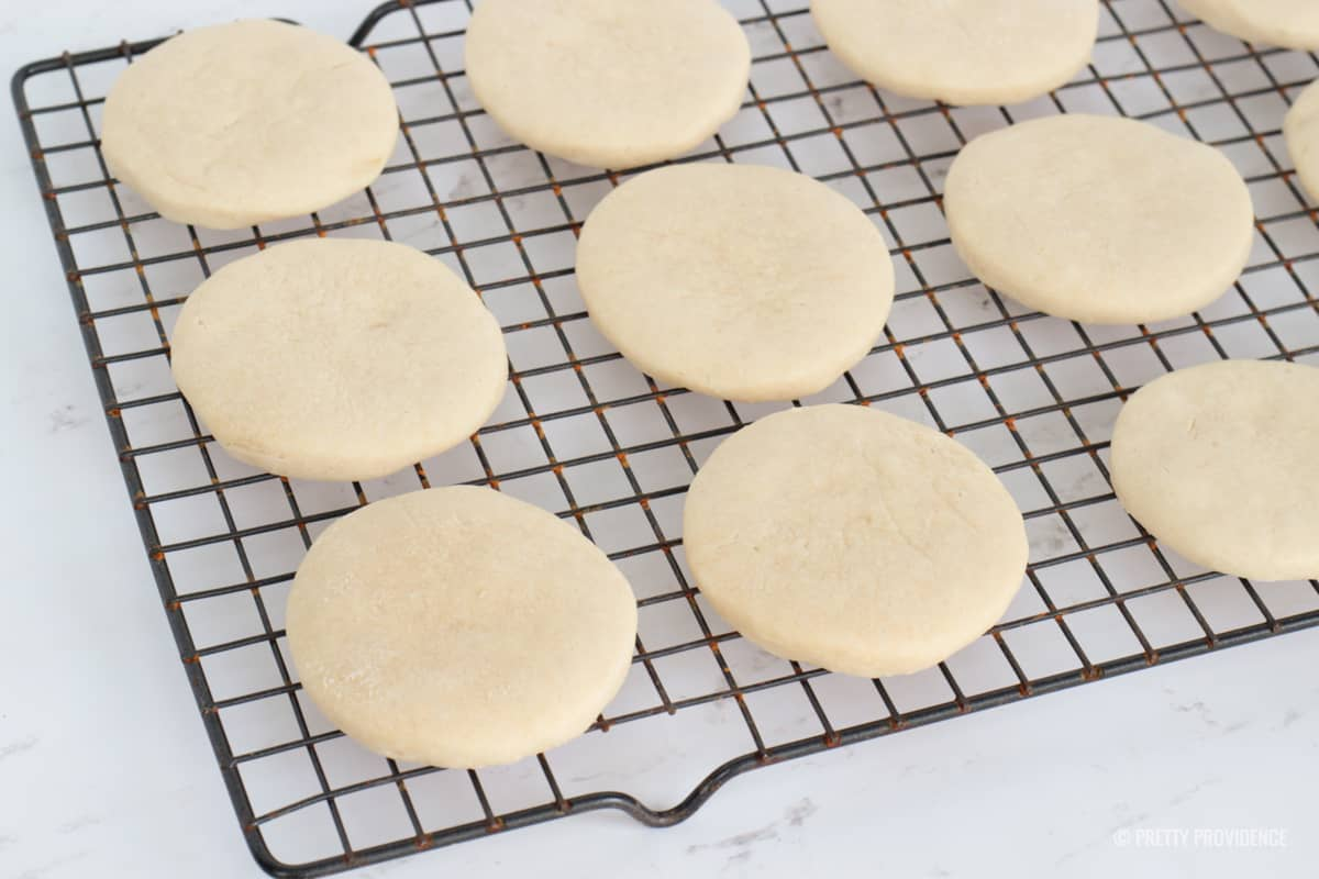 Soft round sugar cookies on a cooling rack