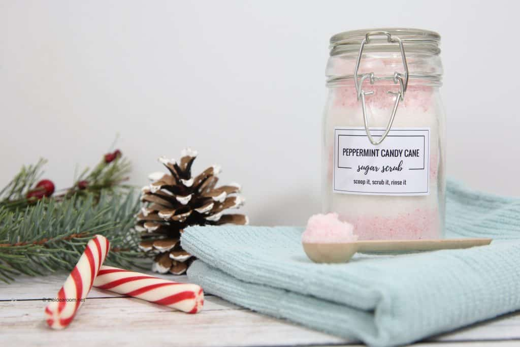 Pink and white Peppermint Candy Cane Sugar Scrub on a blue towel