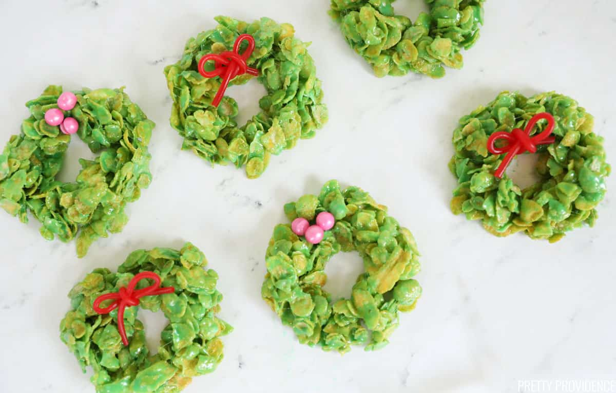 Christmas cornflake wreath cookies marshmallow treats with cinnamon candies, licorice bows