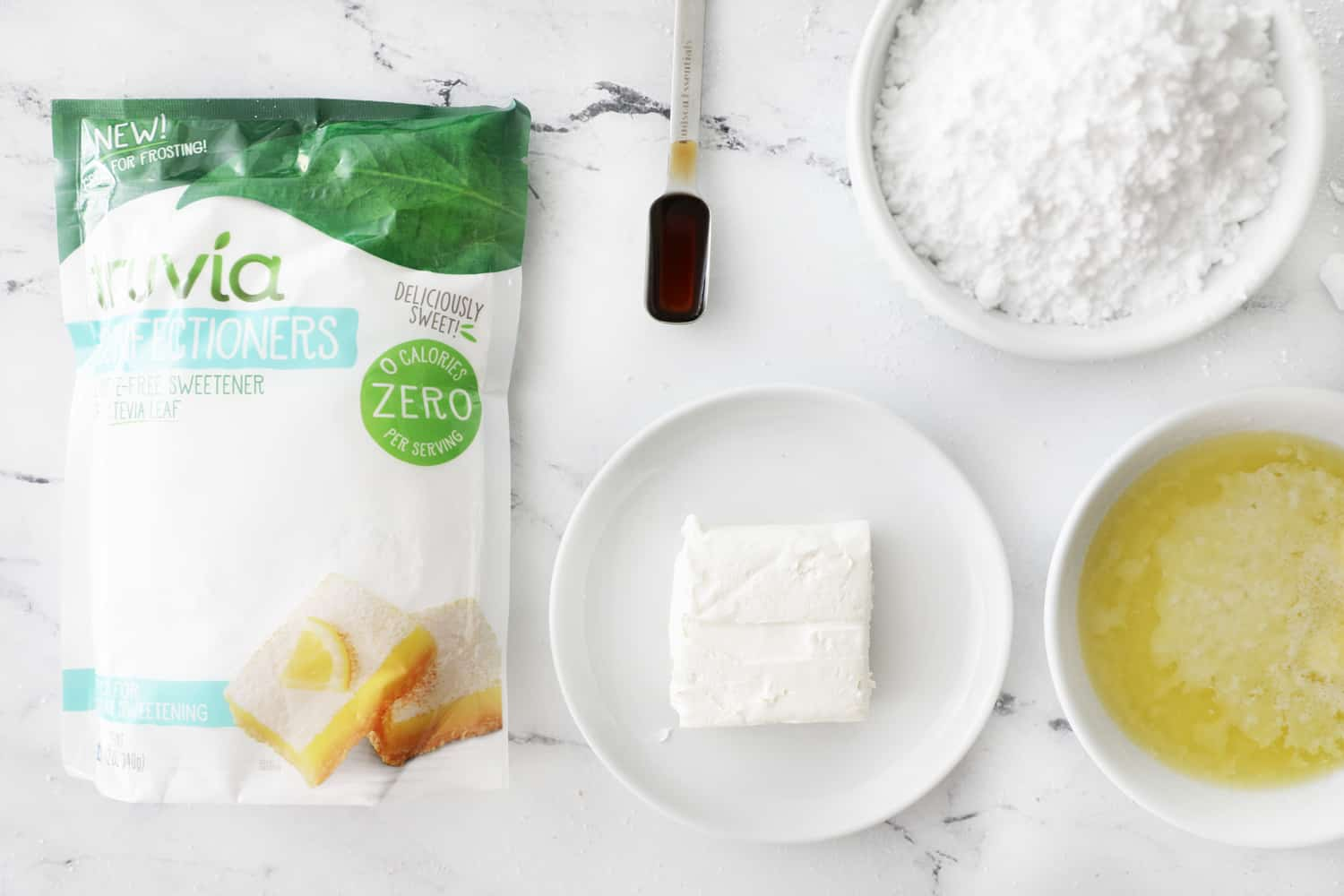 ingredients for low cal cream cheese frosting on white counter