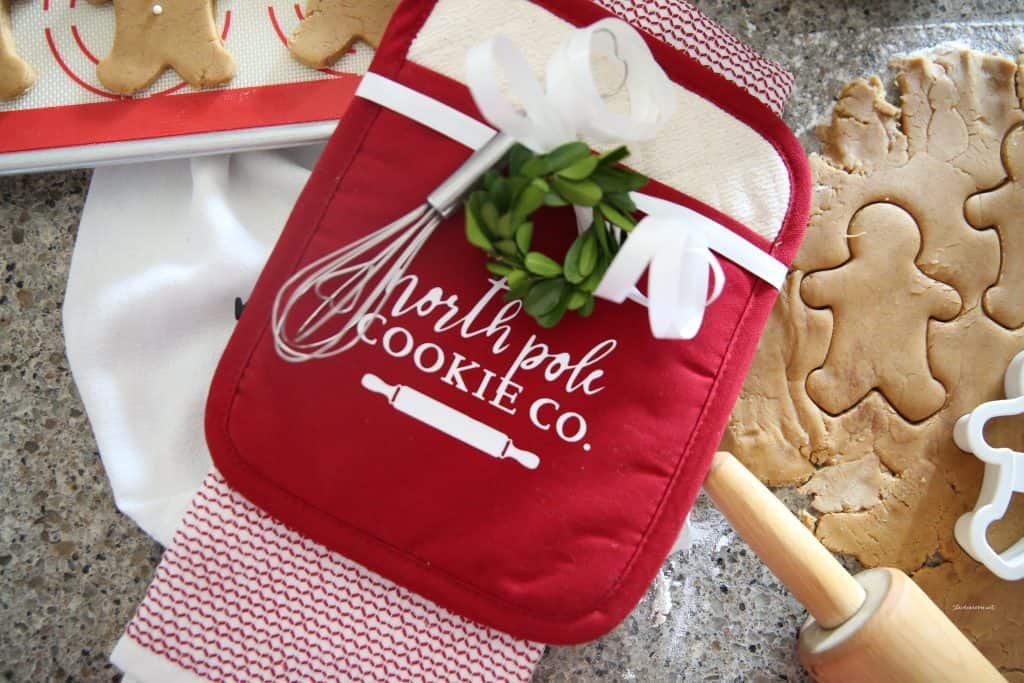 """Baking gift idea, cookie dough and an oven mitt that says """"north pole cookie co."""""""