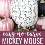 Mickey Mouse pumpkin patterned white and black with pink pumpkins next to it