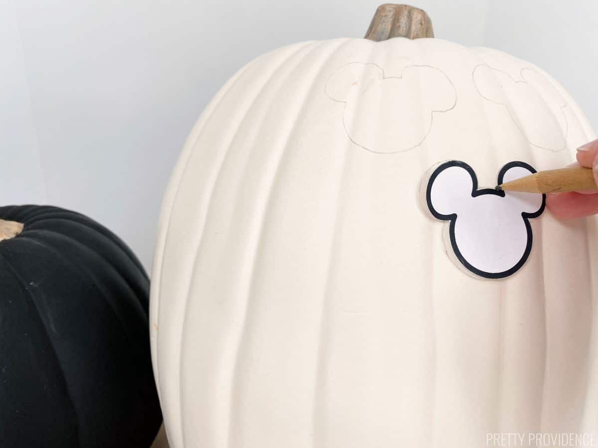 White pumpkin with pencil tracing mickey shape pattern