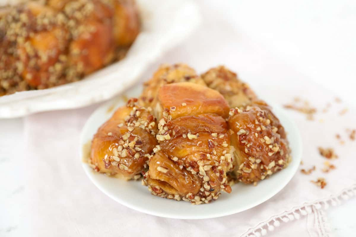 Monkey bread with caramel and pecans on a small plate