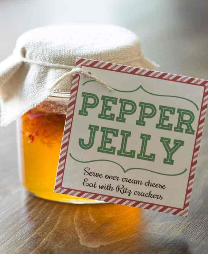 Homemade pepper jelly with a fabric topper and holiday gift tag