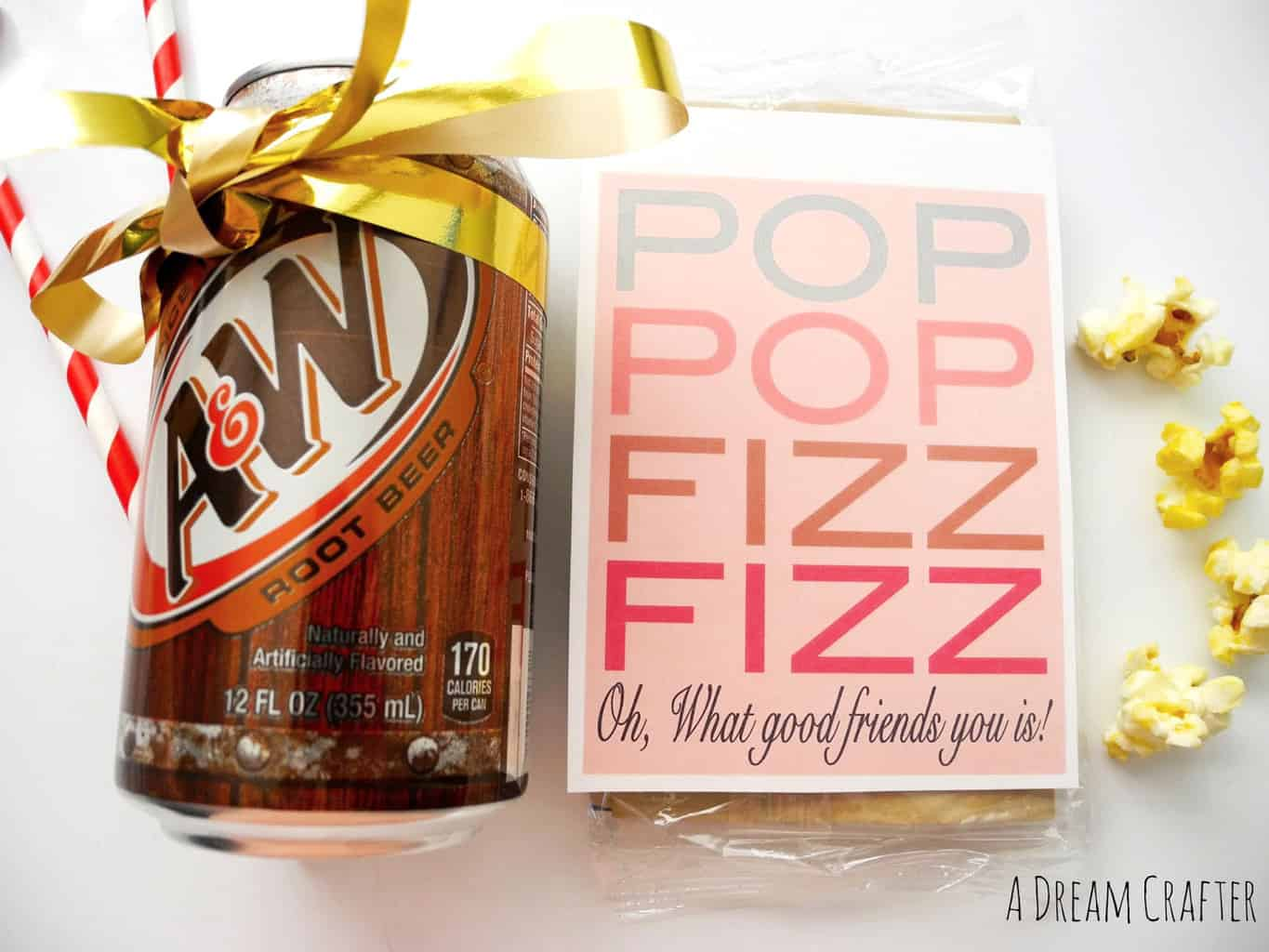Pop Pop Fizz Fizz holiday gift tag on Popcorn and a Root Beer can