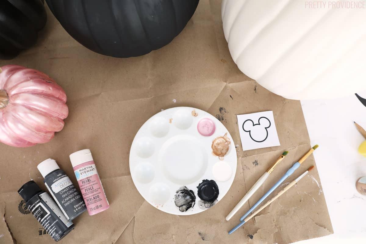 Pumpkin paint supplies, pink, black and gold paint