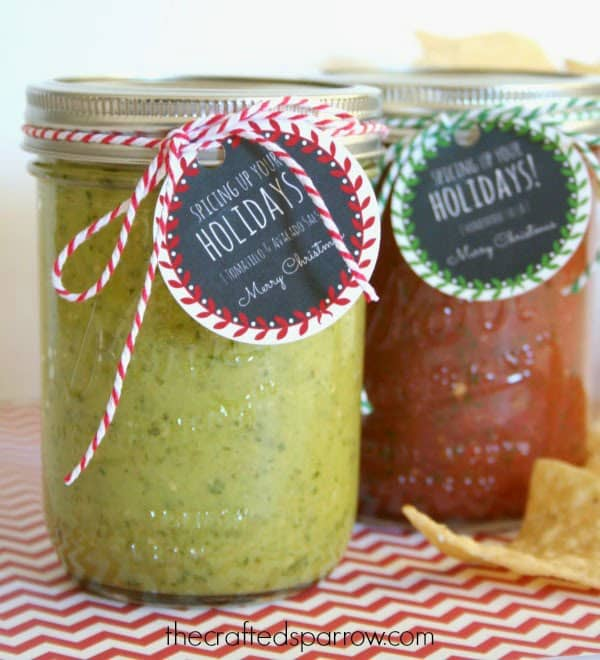 Homemade jars of green and red salsa with Christmas gifts