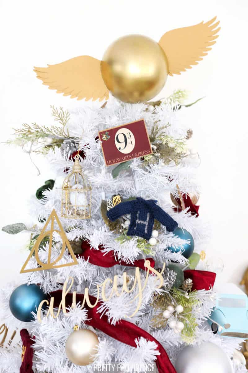 Top half of Harry Potter Christmas Tree with golden snitch topper and DIY ornaments