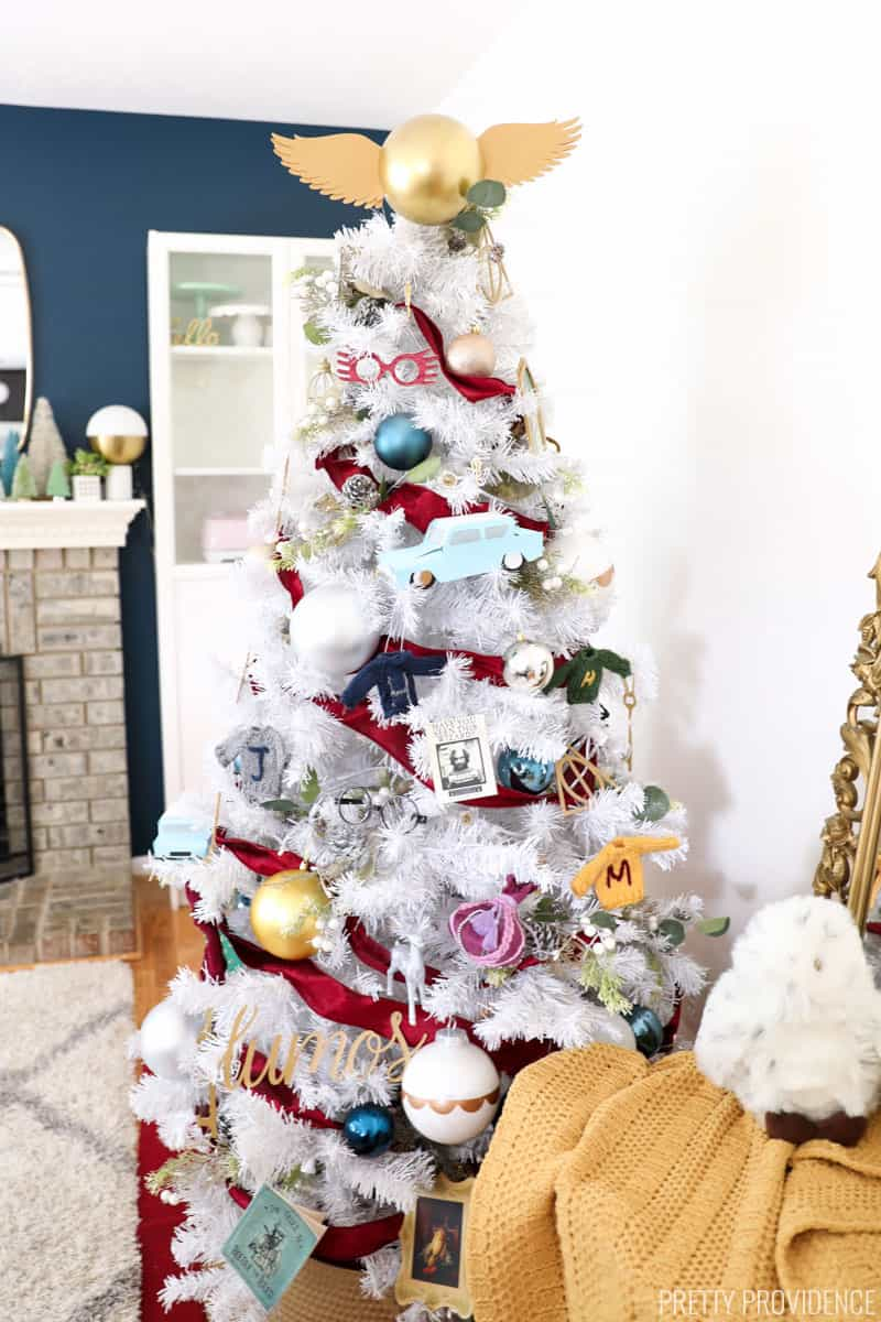 White Christmas tree decorated with Harry Potter Christmas ornaments and golden snitch tree topper