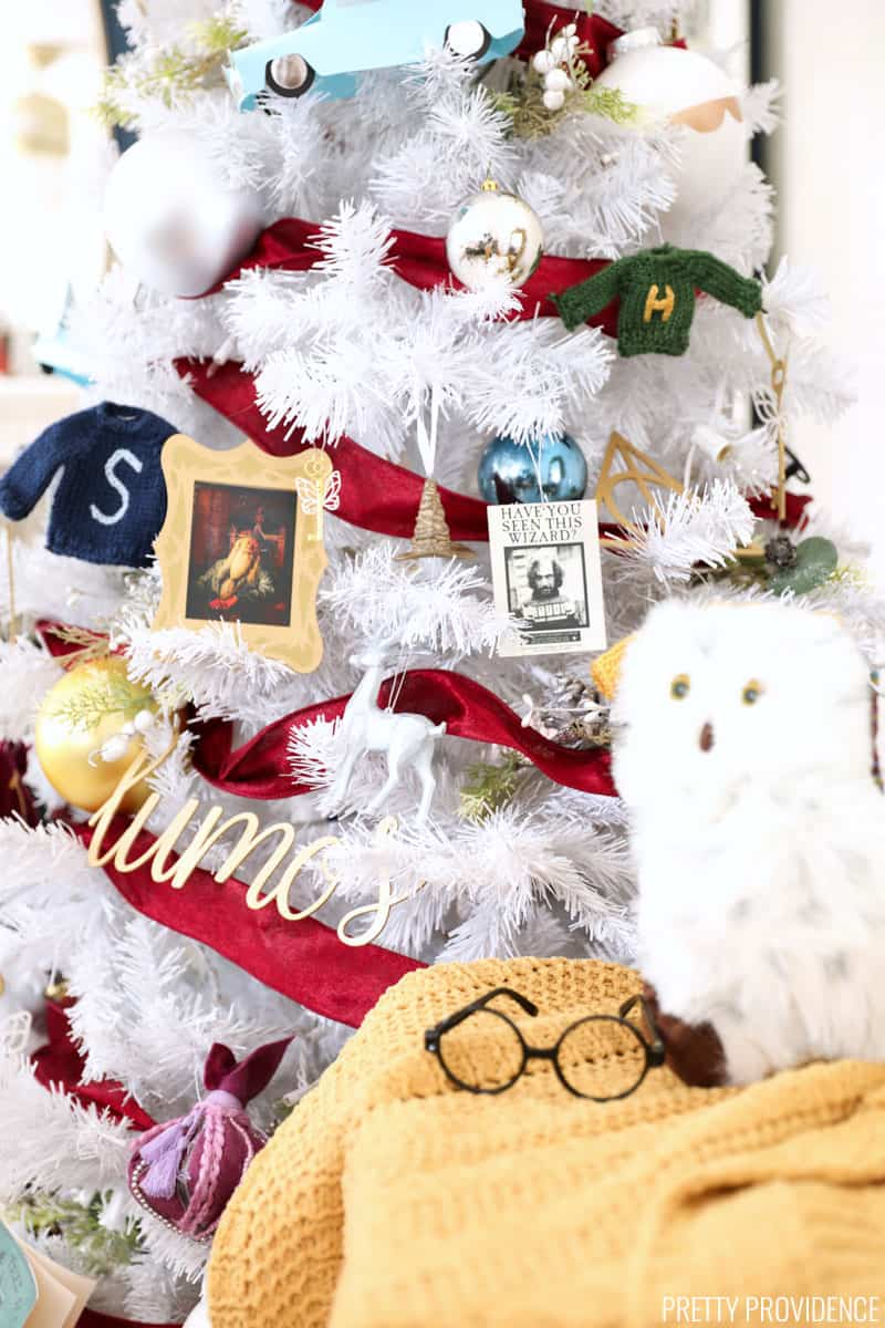Harry Potter Christmas Tree with plush Hedwig and Harry's glasses next to it