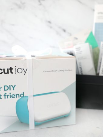 a Cricut Joy in the machine with supplies in the background