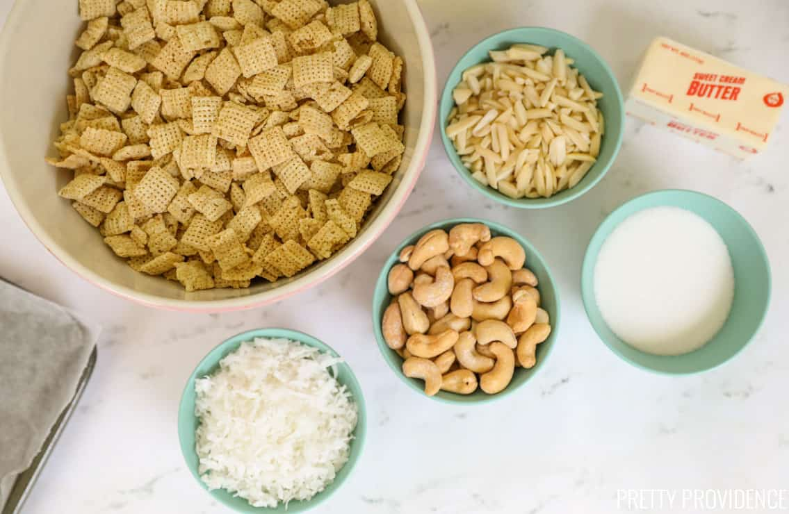 Chex cereal and small bowls of coconut, cashews, almonds and sugar