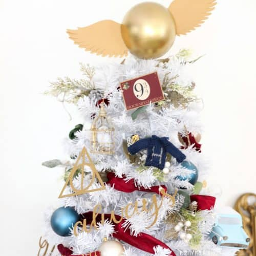 White Christmas tree Harry Potter ornaments and golden snitch tree topper