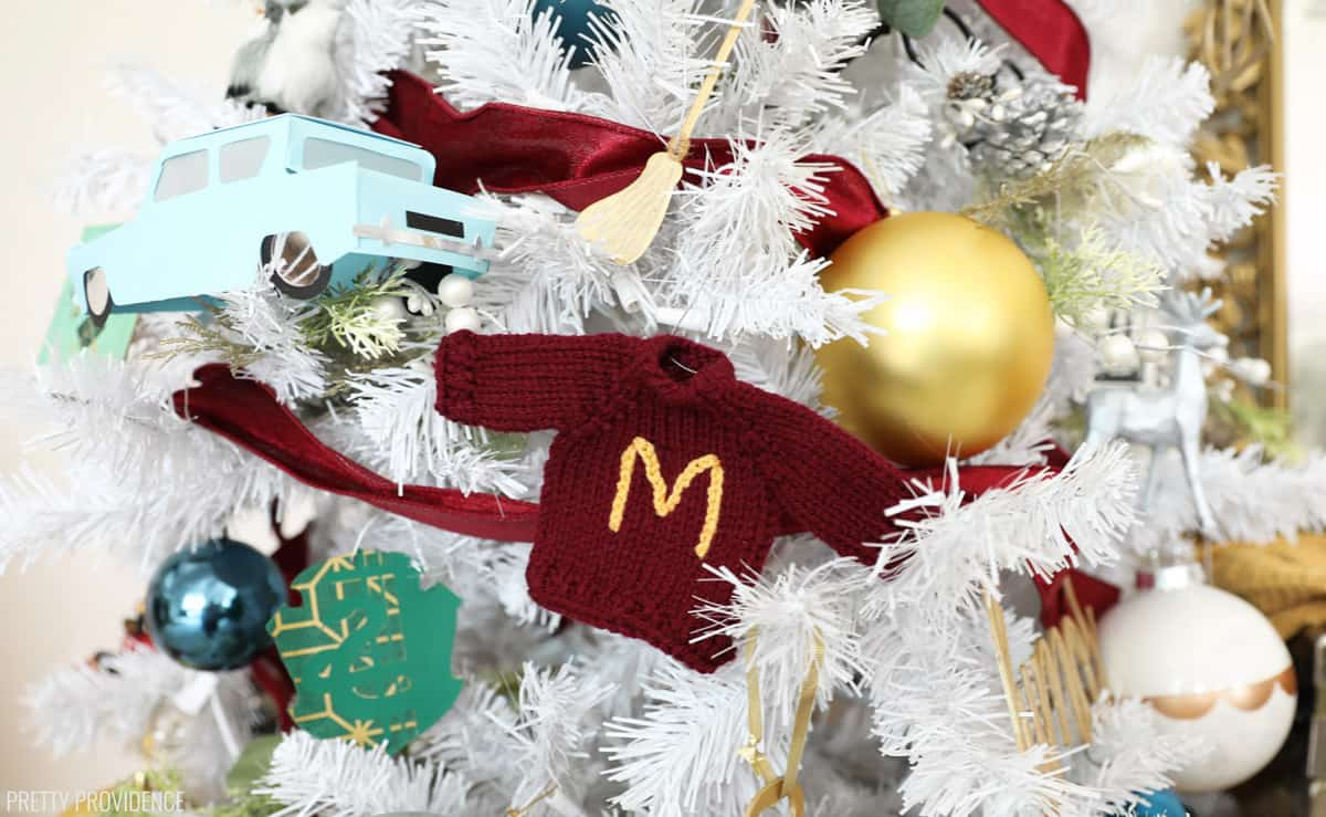 Mini red sweater with yellow 'M' on the front Harry Potter Christmas ornament