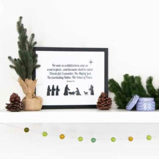 Nativity Printable with bible quote with Christmas decor on a white shelf