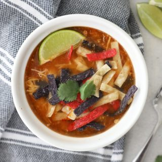 birds eye view of tortilla soup with a lime and tortilla strips