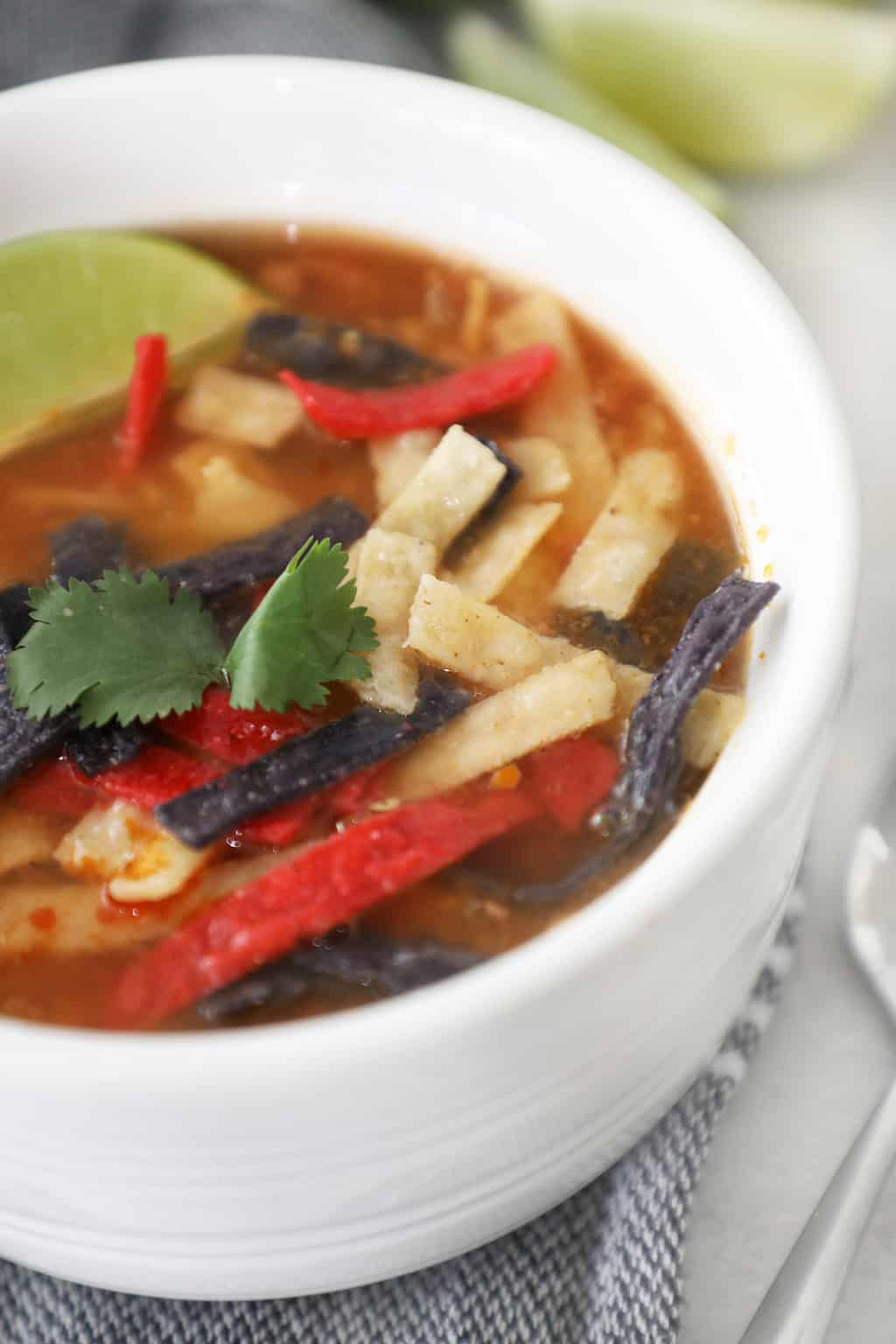 easy tortilla soup in a white bowl garnished with cilantro