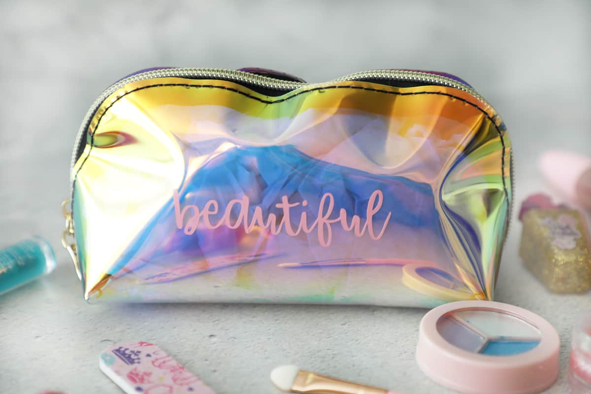 Make up bag that says beautiful in vinyl with kids makeup around it