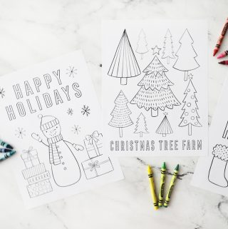 two Christmas themed coloring pages with crayons