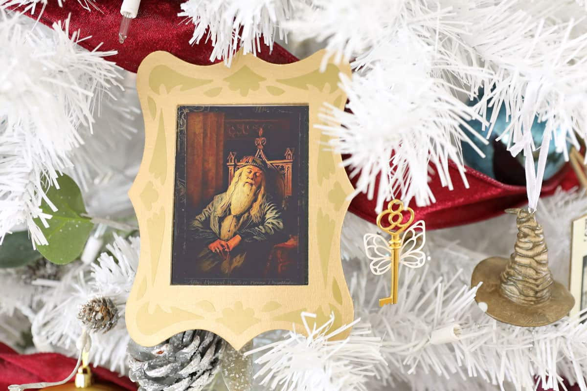 Dumbledore sleeping portrait in gold frame Christmas ornament on white tree