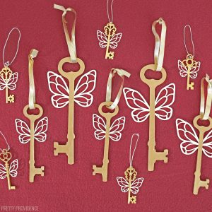 gold Flying Key ornaments from Harry Potter on crimson felt