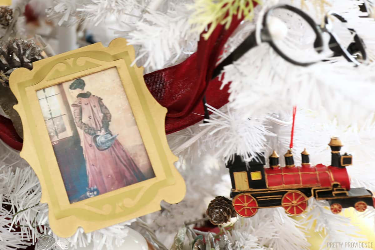 Portrait of McGonagall in gold frame, Hogwarts Express Christmas ornaments and harry potter glasses on white tree