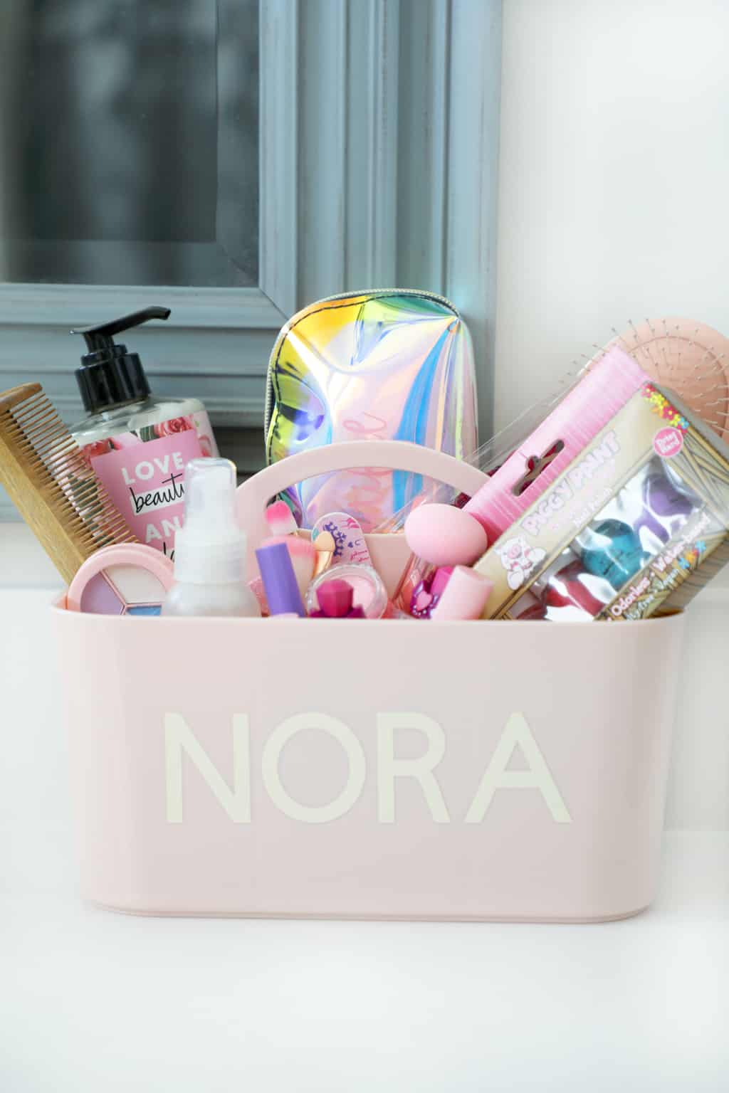 personalized pink make up caddy on bathroom counter