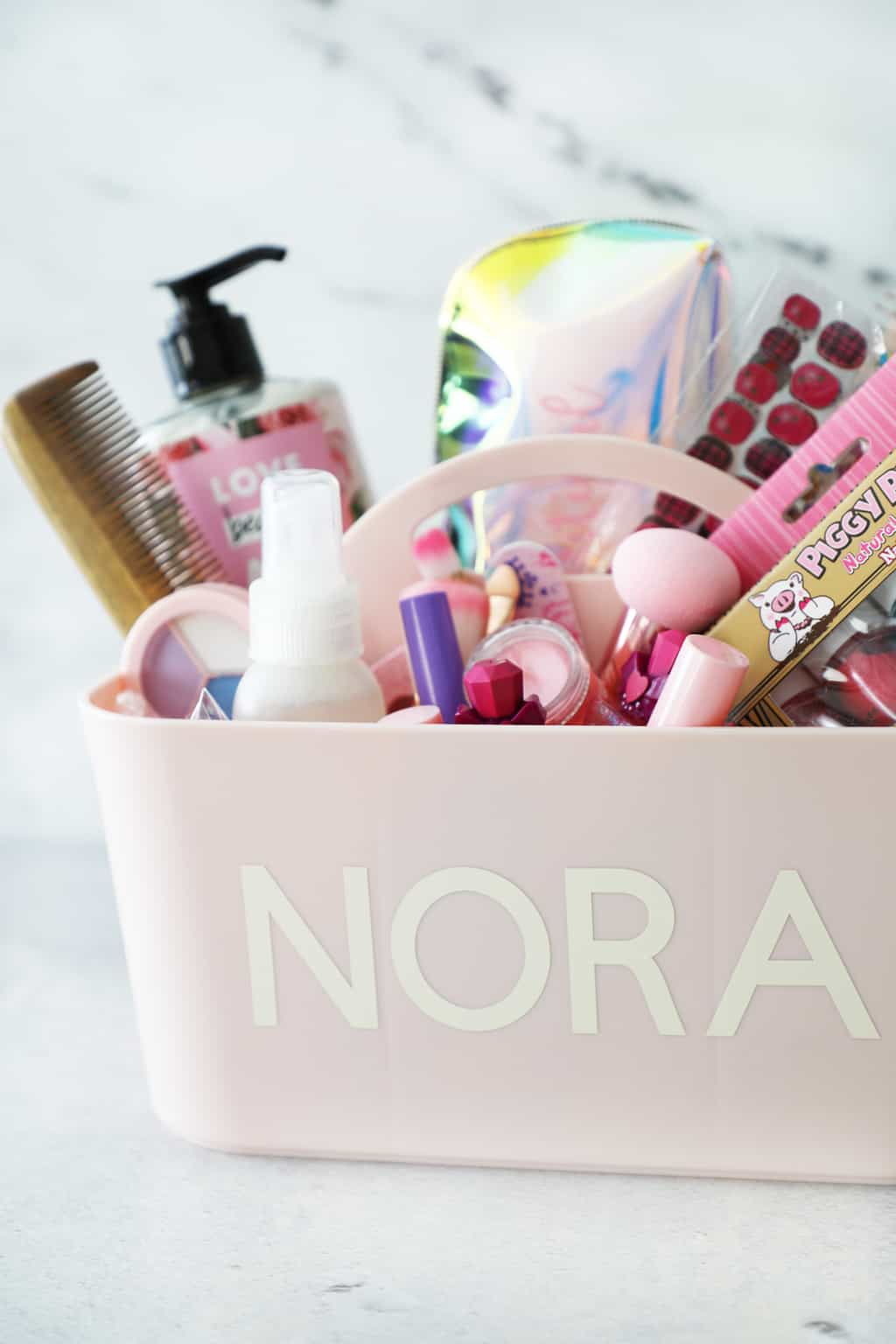 pink makeup caddy with the name Nora on it
