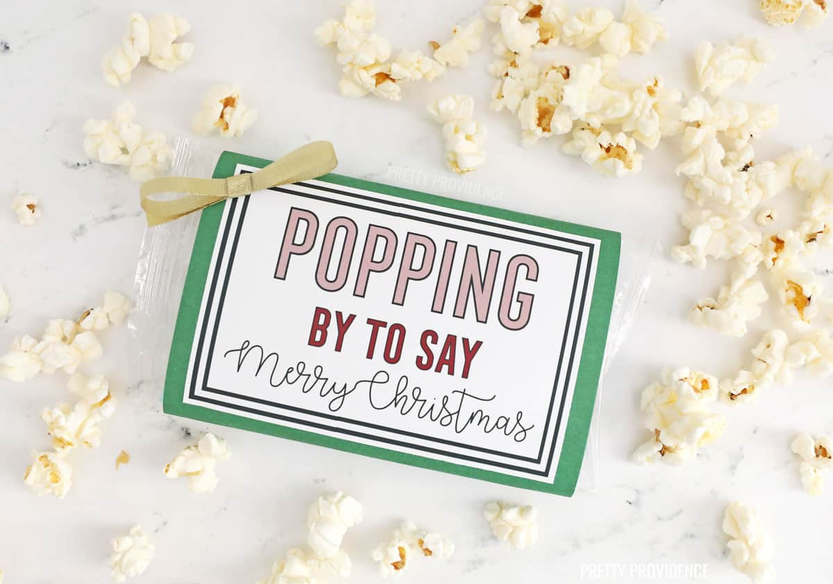 Popcorn package with Christmas tag on the front 'Popping by to say Merry Christmas'