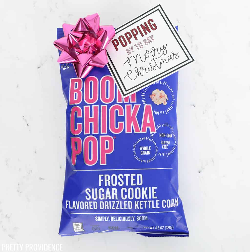 Boom Chicka Pop Sugar Cookie Popcorn with Christmas gift tag and pink bow