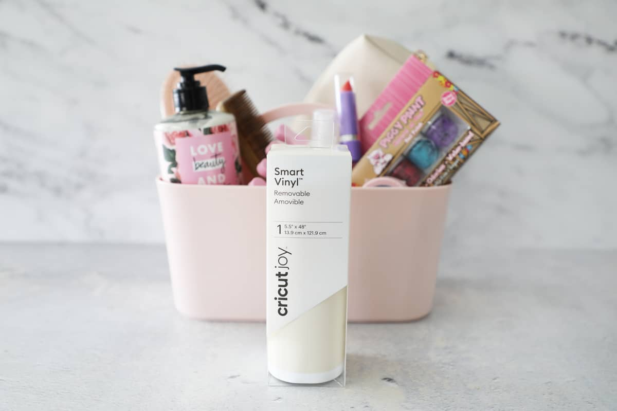 white smart vinyl in front of a makeup caddy filled with supplies