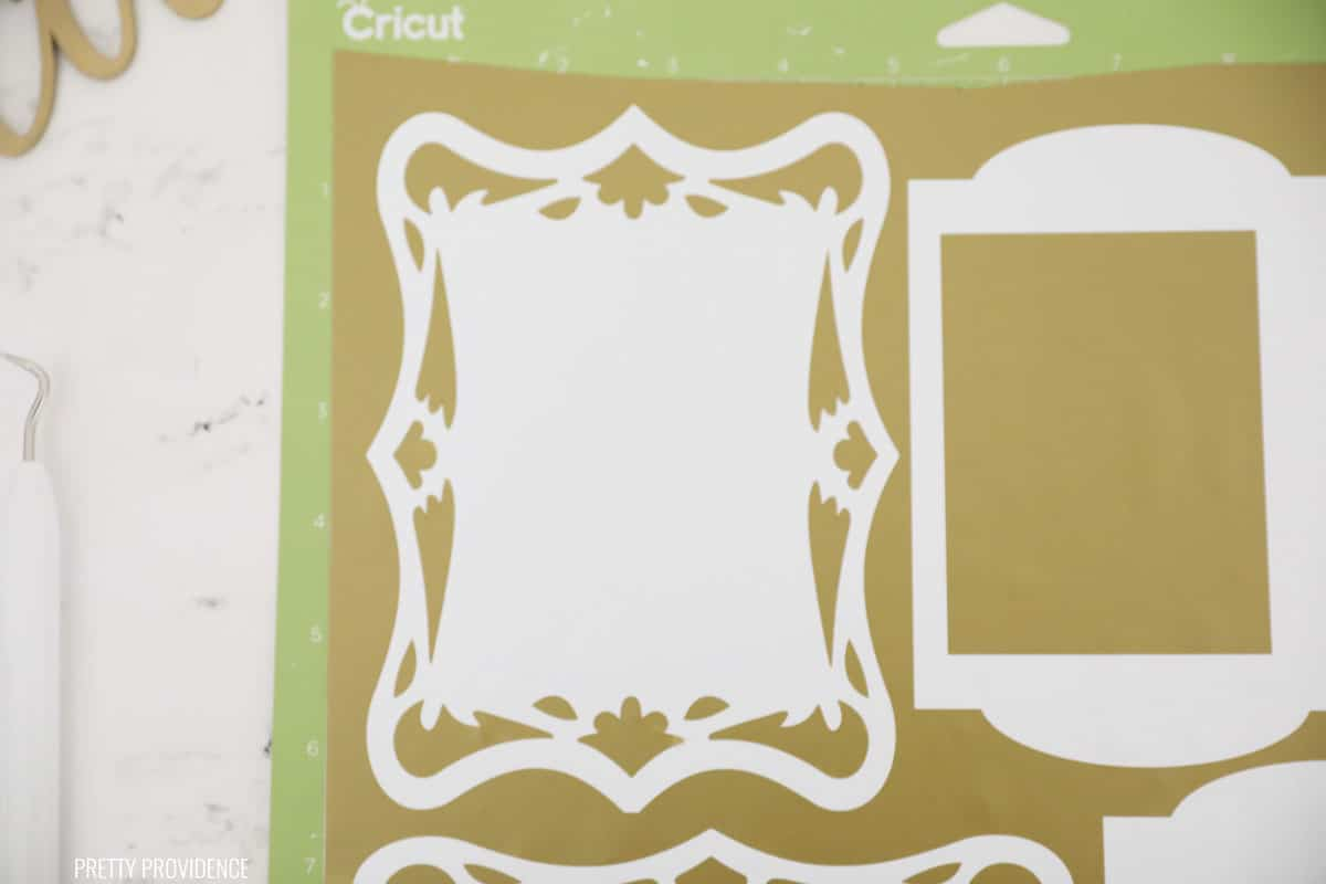 Gold Vinyl with frame embellishments on Cricut green mat