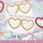 Kids valentines cards with heart glasses taped onto them.
