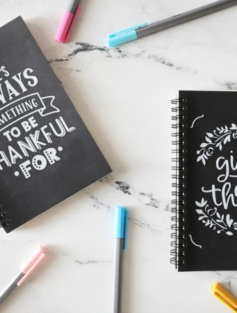 kids gratitude journals on marble countertop with colorful pens